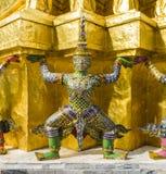 Demon guardian supporting Wat Arun Temple, Bangkok, Thailand. Green demon guardian supporting Wat Arun Temple, Bangkok, Thailand Royalty Free Stock Photos
