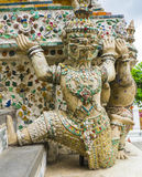 Demon guardian supporting Wat Arun Temple, Thailand Stock Image