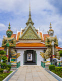 Demon guardians at Wat Arun gate, Bangkok, Thailand Stock Images