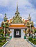 Demon guardians at Wat Arun gate, Bangkok, Thailand. Entrance doorway to ordination hall with Yaksha guardians in the Wat Arun Temple, Bangkok, Thailand Stock Images