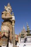Demon guarding Emerald Buddha. Demon statue standing guard at the Temple of the Emerald Buddha in Bangkok, Thailand Royalty Free Stock Photo