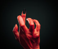 Demon hand with gesture cross fingers Royalty Free Stock Photos