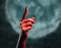 Demon hand pointing upward Stock Image