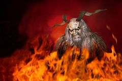 Demon in hell. Demon with Long horns in hell Royalty Free Stock Photo