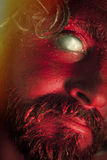 Demon Monster Beard. Demon monster man with beard and frightening eyes royalty free stock photo