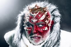 Demon with red face, harp thorns and white fur over dark background. Mystical enchanted creature living in perpetual. Cold. Guardian of permafrost land, fairy Royalty Free Stock Photography