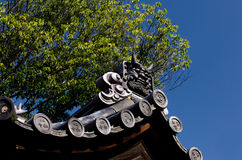 Demon roof tile on temple`s roof, Kyoto Japan Royalty Free Stock Photography