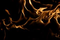 Demon som ser från brand Arkivbild