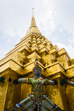 The demon statue supporting golden pagoda Stock Photography