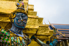 The demon statue supporting golden pagoda at Wat Phra Kaew (Temple of the Emerald Buddha) Stock Photos