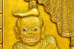 Demon statue under foot Royalty Free Stock Image