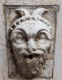 Demon in stone. Decoration of an ancient building in Italy of a demon in stone Stock Photos