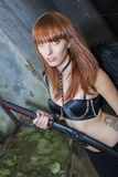 Demon. Stunning redhead model posing as a demon with black wings Royalty Free Stock Photo