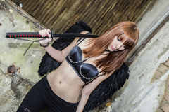 Demon. Stunning redhead model posing as a demon with black wings Stock Images