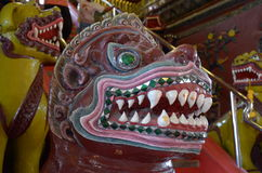 Demon at Wat Phra Mahathat. The staircase leading to the Stupa is guarded by demon Lion. The shape of a lion`s open mouth seen fangs stock images