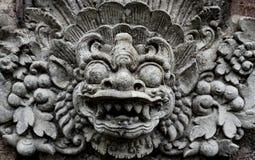 Demone di balinese scolpito in pietra fotografia stock
