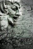 DEMONIC BACKGROUND. Montage of demonic sculpture on texture Stock Photos