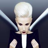 Demonic blonde girl. Fashion hairstyle Royalty Free Stock Images