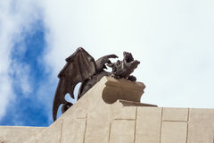 Demonic gargoyle reaching for the sky. Stock Photos
