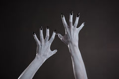 Demonic hands with black nails Royalty Free Stock Image
