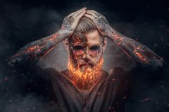 Demonic male with burning beard and arms. Demonic male with burning beard and arms in fire sparks Royalty Free Stock Images