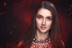 Demonic red beauty Stock Images