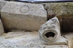 Demonic relief in Romanesque church facade royalty free stock photography