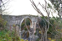 The demons bridge, Vulci. Italy. People from the area says this bridge was the first to be built and named as the Demon Bridge Royalty Free Stock Photo
