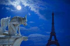 Demons and Eiffel tower under moonlight Royalty Free Stock Photo