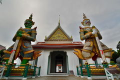 The demons at the entrance. Wat Arun. Bangkok. Thailand Stock Photography