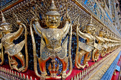Demons holding up a temple. In the Grand Palace, Bangkok, Thailand stock image