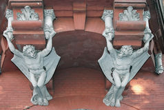 Demons on wall of Castle of a Baron in Kiev, Ukrai Stock Photo