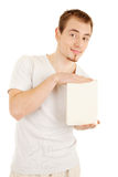Demonstation of a nice book. Handsome young man demonstrates a book by two hands. Image include clipping path for the book Stock Image