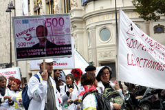 Demonstation on salary and unemployment  in Paris. Employee of French drugmaker Sanofi attends a demonstration in Paris to protest planned layoffs, France Stock Images