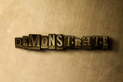 DEMONSTRATE - close-up of grungy vintage typeset word on metal backdrop. Royalty free stock illustration.  Can be used for online banner ads and direct mail Royalty Free Stock Photos
