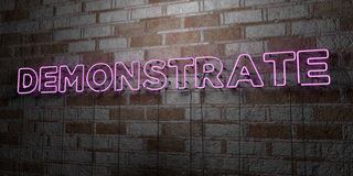 DEMONSTRATE - Glowing Neon Sign on stonework wall - 3D rendered royalty free stock illustration. Can be used for online banner ads and direct mailers Stock Photo