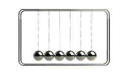 Demonstrate laws. Metal pendulum in perfect balance to demonstrate stable economic situation Stock Photo