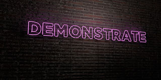 DEMONSTRATE -Realistic Neon Sign on Brick Wall background - 3D rendered royalty free stock image. Can be used for online banner ads and direct mailers Royalty Free Stock Photography