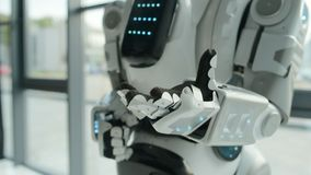 Close up of robot stretching hand stock footage
