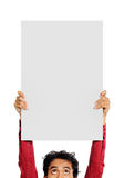 Demonstration. Man with funny expression holding a big white blank card Stock Images
