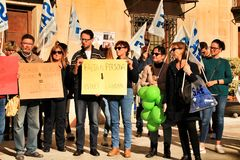 Demonstration against cuttings of sanitary personnel in Elche. Elche, Alicante, Spain- December 1, 2018: People with banners in demonstration against cuttings of royalty free stock images