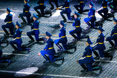 The Demonstration band of the Armed Forces and the Honor Guard of the Republic of Belarus at the Red Square. MOSCOW, RUSSIA - AUGUST 26, 2016: Spasskaya Tower Royalty Free Stock Photos