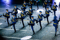 The Demonstration band of the Armed Forces and the Honor Guard of the Republic of Belarus at the Red Square. MOSCOW, RUSSIA - AUGUST 26, 2016: Spasskaya Tower Stock Images