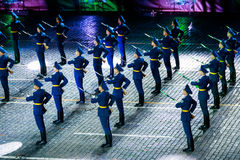 The Demonstration band of the Armed Forces and the Honor Guard of the Republic of Belarus at the Red Square. MOSCOW, RUSSIA - AUGUST 26, 2016: Spasskaya Tower Royalty Free Stock Image