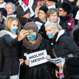 The demonstration of the Committee of the Defence  of the Democracy  KOD  for free media /wolne media/. CRACOW, POLAND - JANUARY 9, 2016:  -  The demonstration Royalty Free Stock Images