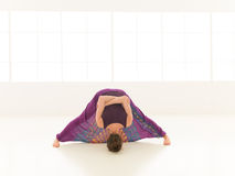 Demonstration of difficult stretching yoga pose Royalty Free Stock Photography