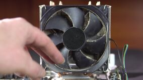 Demonstration of dust pollution. Dirty cooler and CPU heatsink from dust.