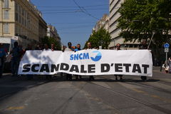 Demonstration by employees of the National Society Corse Méditerranée (SNCM). Employees of the Societe nationale Corse Mediterranee (SNCM) hold banners as royalty free stock image