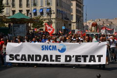 Demonstration by employees of the National Society Corse Méditerranée (SNCM). Employees of the Societe nationale Corse Mediterranee (SNCM) hold banners as stock photo