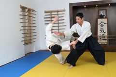 Demonstration of fighting art Aikido. In  sports hall (dodjo Stock Photography